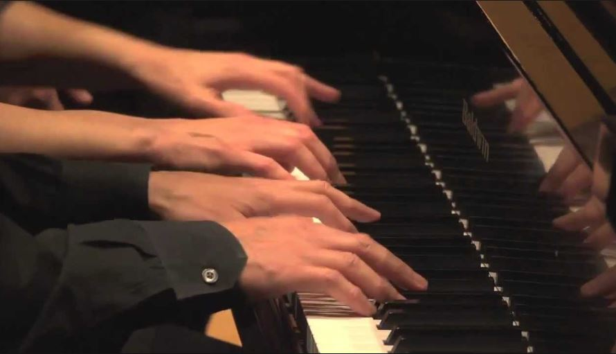 four-hand piano by Rev. Jim Alexander and Elaine Bunney